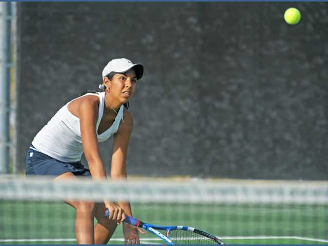 West Ranch No. 1 singles player Ana Cecilia Fuentes watches her shot against Sage Hill in the CIF-Southern Section Division III semifinal match on Thursday at West Ranch. For the second straight year the Wildcats' season ended at the hands of the Lightning.