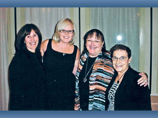 From left to right, Candy Spahr, winner of the Community Leadership Award; Cassie Taylor, American Cancer Society Gala Auction Committee volunteer; Nancy Coulter, Volunteer of the Decade; Agnes Russell, Community Outreach Award.