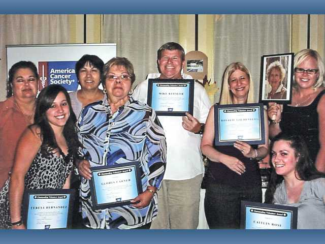 Outstanding Volunteer Team winners Office Coordinators display their certificates of recognition.