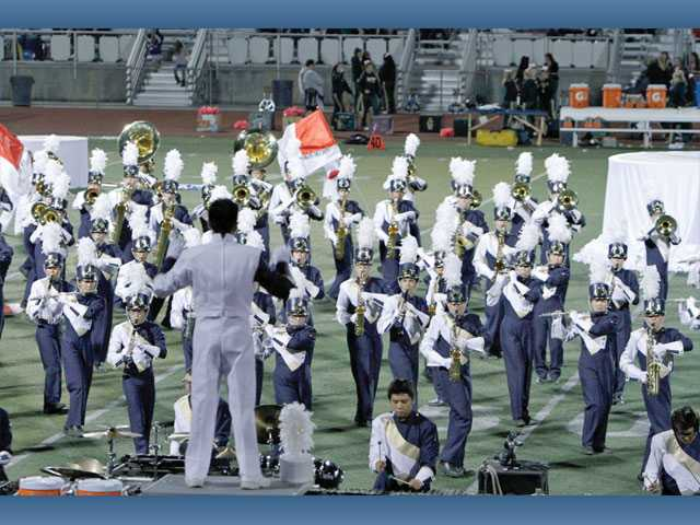 "Drum Major Eric Park conducts the West Ranch High School 2011 field show, ""White Out,"" in October. West Ranch won an unprecedented five trophies at their first show in Baldwin Park on Oct. 22."