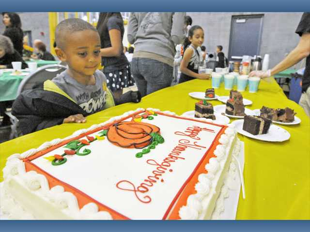 Tommy Ward, 5, eyes the cake before it's served.