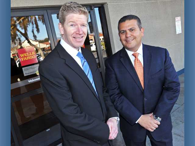 Dave Schelling, senior vice president and wealth adviser, left, and Vladimir Victorio, vice president and senior private banker, stand in front of Wells Fargo's Valencia branch.
