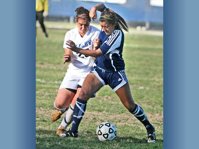 College of the Canyons' Nicole Guerrero, right, battles for the ball against San Bernardino Valley College's Maddy Horan on Tuesday at College of the Canyons in the CCCAA So Cal Regional second round.