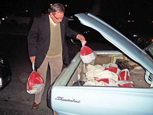 Jeff Hacker delivers turkeys from the trunk of his '65 T-Bird.