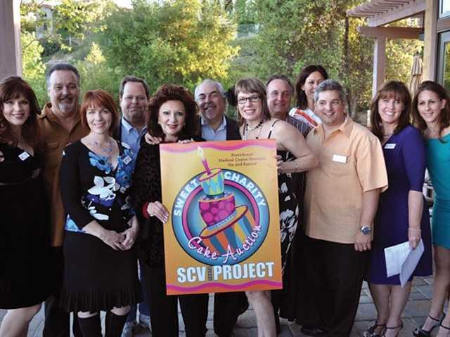 Members of the SCV Youth Project board gather for a group photo to promote the SCV Youth Project Sweet Charity Cake Auction, the nonprofit's annual fundraiser.