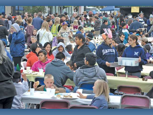 Hundreds enjoy their free meals.