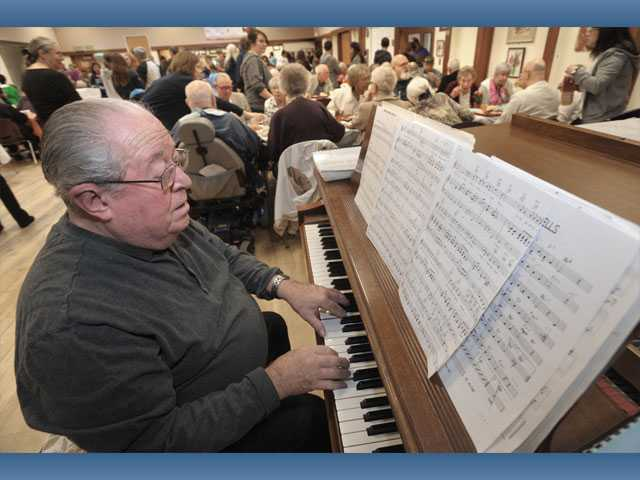 Pianist Maurice Tucci entertains with holiday favorites.