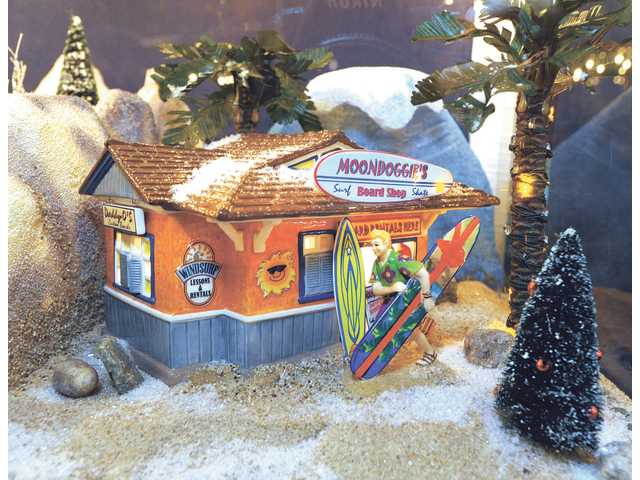 Moondoggie's Board Shop, part of the Snow Village in the Dept. 56 display at Green Thumb. Moondoggie's is one of the newer Dept. 56 buildings available. Other villages include Dicken's Village, New England Village, Alpine Village and North Pole Village.