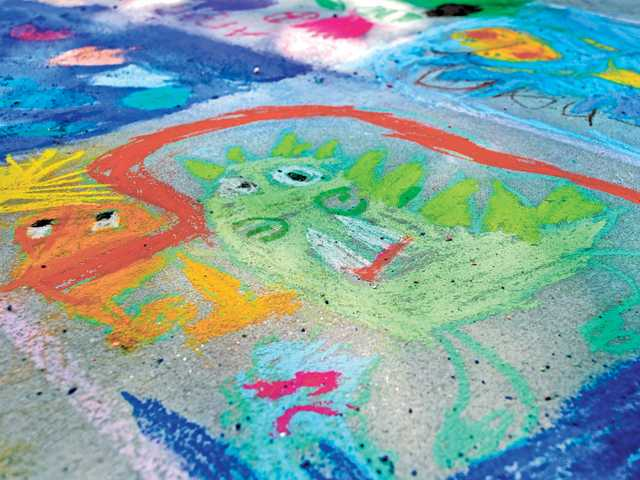 Students at Highlands-Emblem Elementary School created colorful chalk drawings on the blacktop.