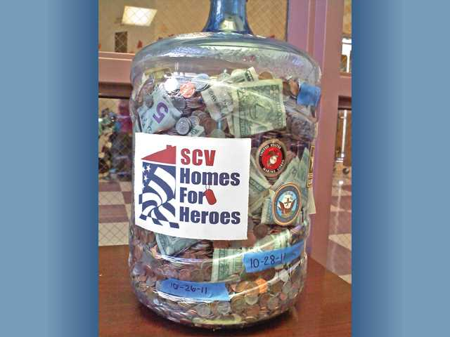 Plum Canyon Elementary School's Homes for Heroes jug is seen after the final day of collection.