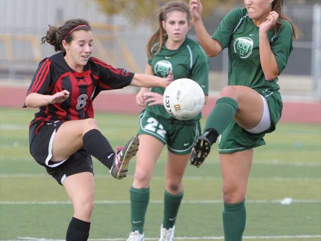 Hart midfielder McKinley Kane, left, stabs at the ball as Thousand Oaks defender Gabby Suarez does the same on Tuesday at Hart High School. The Indians had opportunities but couldn't finish in a scoreless tie.