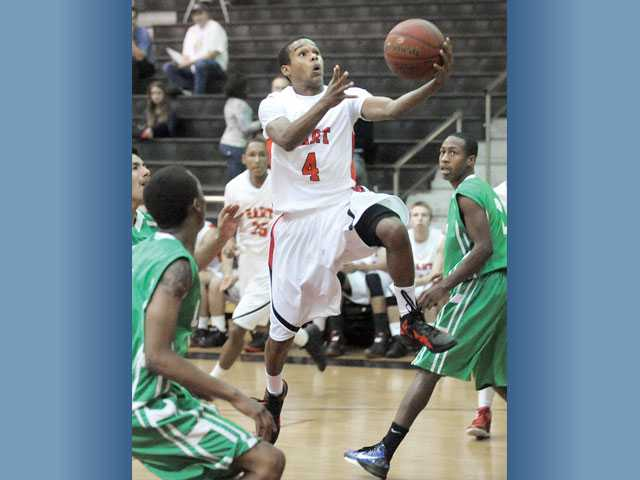 Hart guard James Chevious scoops a shot against Littlerock on Tuesday at Hart High School. Hart won 92-77.