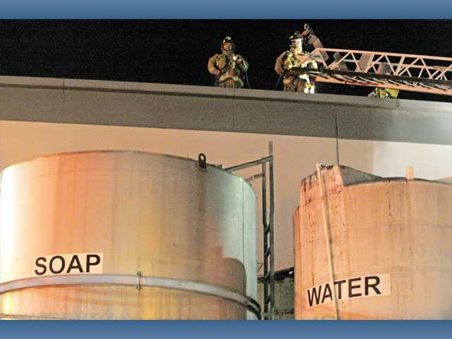 Firefighters work the scene of a flash fire at Bocchi Laboratories in Santa Clarita on Wednesday night.