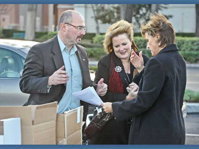 Assemblyman Tim Donnelly, left, and Assemblywoman Shannon Grove, center, talk to Judi Corfino, of Valencia, while they petition to stop the Dream Act, in a Stevenson Ranch parking lot on Wednesday.