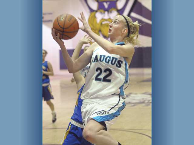 Saugus High's Kim Smither (22) goes in for a layup against Nordoff High School at Valencia on Wednesday. The Centurions won their first game of the Valencia High Five Classic by defeating the Rangers 68-21.