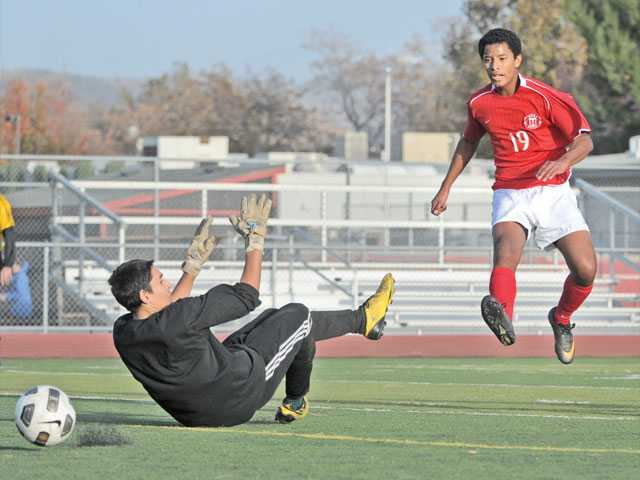 Hart's Eddy Castillo (19) shoots and scores past Moorpark goalkeeper Florencio Morales on Thursday at Hart High.