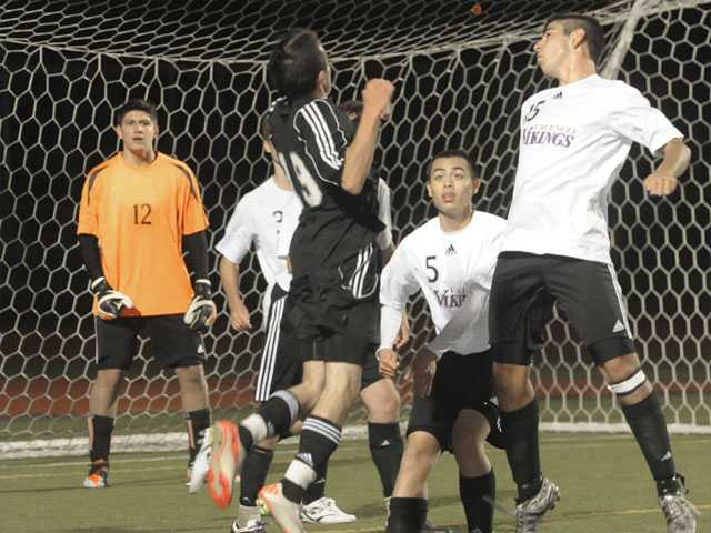 Valencia defenders, from left, goalkeeper Gino Ferraro (12), Aaron Chamness (3), Erik Juico (5) and Brett Schreiber (15) swarm Stockdale's Brenden Silva (19) at Valencia High on Friday.