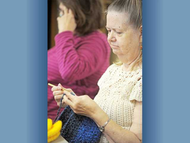 Penny Hamilton, 67, of Castaic, knits a hat.