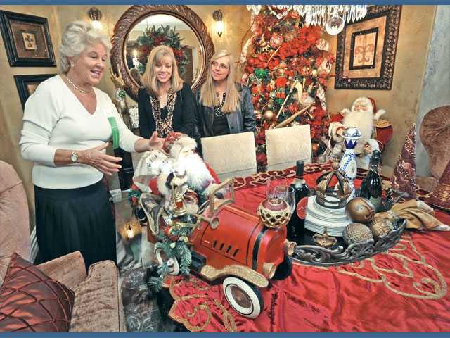 "Heidi Horak, center, and Kathy Meter-Mahler, right, listen as home tour hostess Adrianne Redstall, left, describes the Christmas decorations at ""Christmas at Casa de Avila,""  the home of Martin Avila and Fredye Gonzales on Shadow Rock Lane in Westridge as part of the annual Henry Mayo Newhall Memorial Hospital Holiday Home Tour on Saturday."