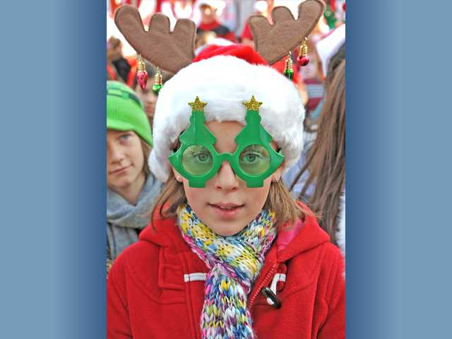 Kaitlin Greiner, 10, dons Christmas tree glasses and antlers. Kaitlin sang with the Newhall School District Choir at the event.