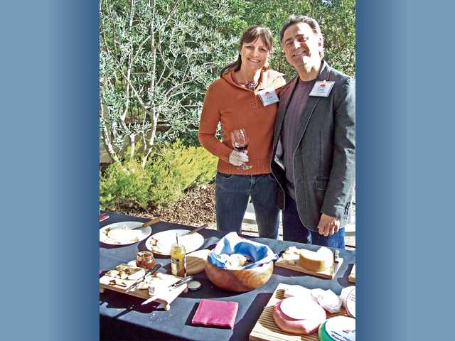 Carol and Corry De Robertis served artesian hand-crafted cheeses.