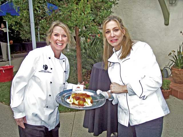 Michelle Razzano and Cindy Schwanke of the Culinary Arts Program at College of the Canyons offer up a baked brie with homemade fig jelly.