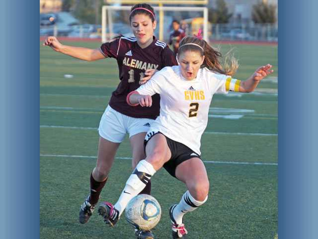 Golden Valley's Lauren Bermudez (2) battles for the ball with Alemany's Jazmin Delia on Thursday at Golden Valley High School.
