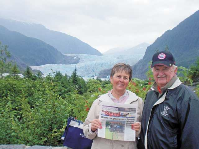 Georgene and Harry Christensen pose with The Signal, near the Mendenhall Glacier, as part of a cruise in August.