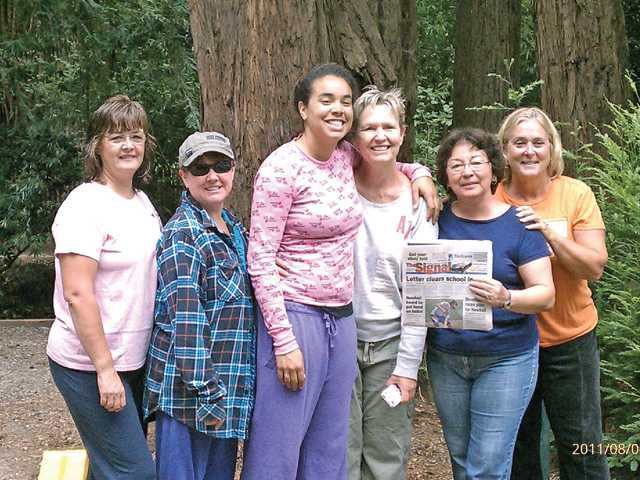 Kathy Cooper, Yvonne Matuta, Suzanne Meadows, Marisa Meadows, Loretta Knapp and Pam Estrada pose with The Signal during an RV camping trip to Santa Cruz in August.