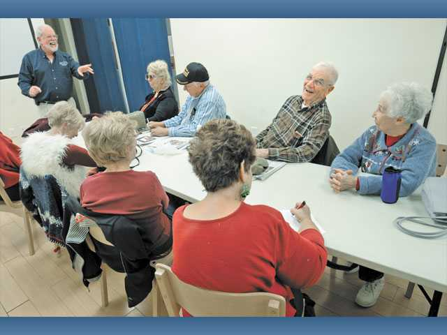 "Dr. Michael Holt, left,  leads a class for seniors entitled ""The Power of Positive Thinking"" at the SCV Senior Center on Thursday."