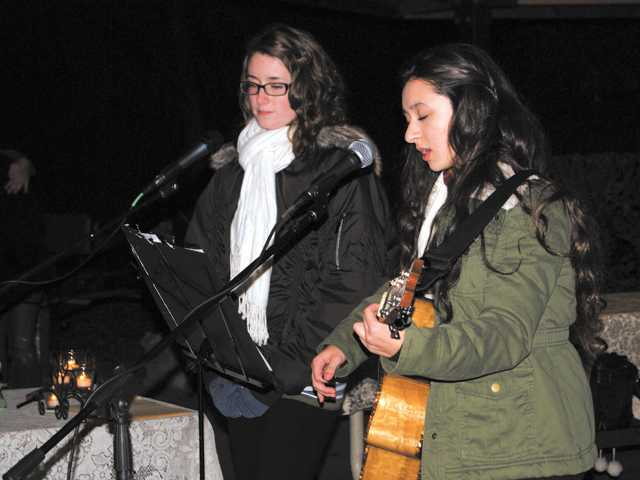 Singer Brianna Hanzmann and guitarist Savannah Perino perform at the Compassionate Friends candle-lighting ceremony at Canyon Country Park on Sunday night.