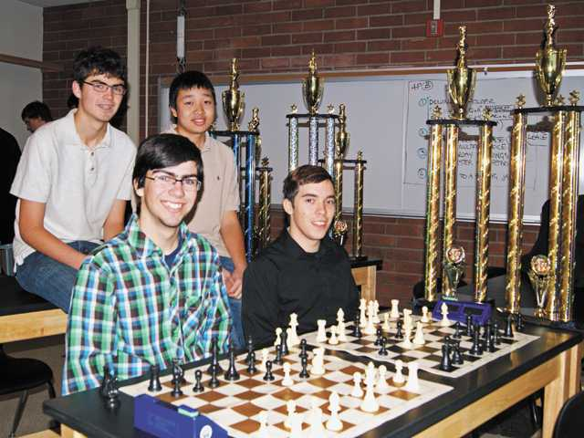 From left, back row: Tommy Hart and Anthony Wong; front row: Jackson Stallings and Sam Kennedy, members of Hart High School's chess team, pose with their trophies. The players emerged as the Western champions at the 2011 National Youth Action Chess Championships this weekend.