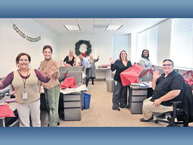 Employees of Princess Cruises recently wrapped gifts for families adopted by the Princess Cruises Community Foundation. The Foundation adopted 100 families from Single Mothers Outreach. Princess employees formed teams to shop and wrap the gifts which will be presented at a reception on Saturday.