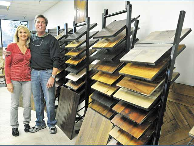 Donna and Greg Glasnow stand in hardwood floor manafacturer Aged Timber's Sylmar showroom on Tuesday.