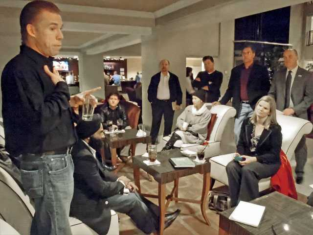 Erick Arndt, left, creator of SCV Startup, explains his vision to the group at a meeting Tuesday at the Embassy Suites Valencia.