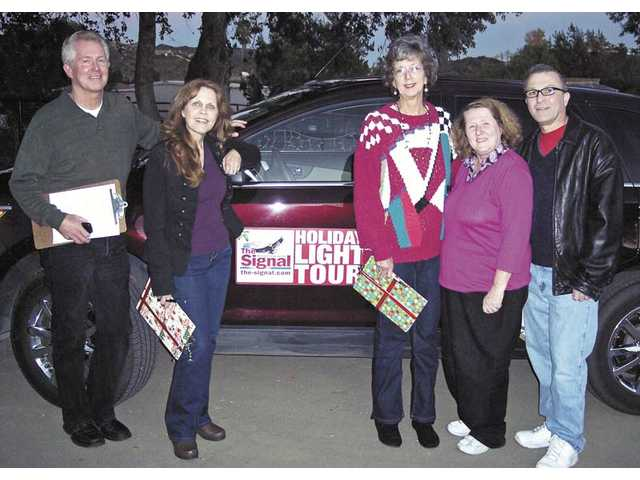 The Holiday Light Tour judges, from left, Jim Walker, Jana Adkins, Lila Littlejohn, Michele Buttelman and Jason Schaff.