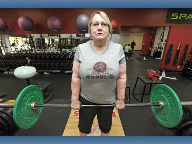 Morton practices her dead lift. She began power-lifting to get out of a deep depression caused by the death of her son from cancer. The sport gave Morton something to look forward to, as well as energy to get through the day.