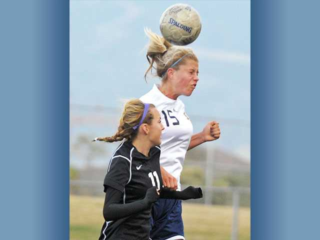 West Ranch's Savanah Tujague (15) wins a header against Ventura's Tavara Johnson on Thursday at West Ranch.