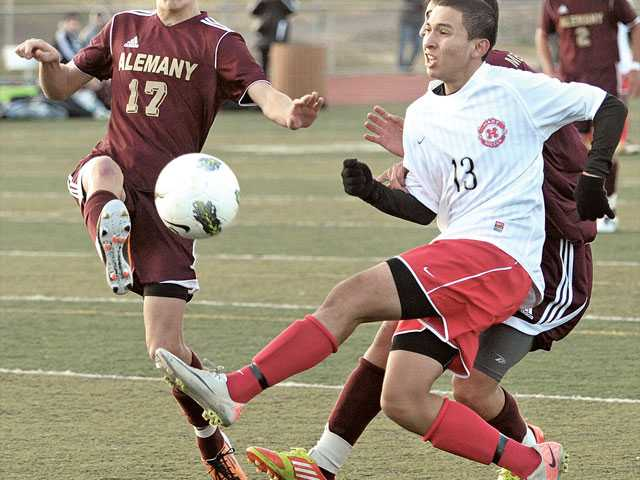 Hart's Oscar Ocampo (13) takes a shot as Alemany defender Thiago Delia (17) tries to block it on Thursday at Hart High School. The Indians scored in the second half to beat the Warriors 1-0 in preleague action.