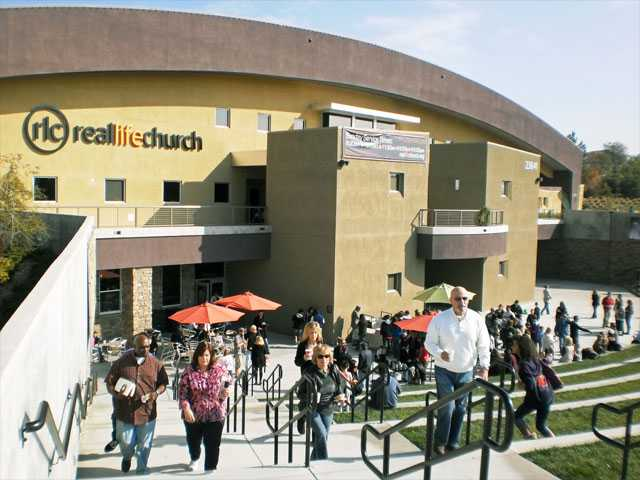 People congregate outside after a recent Sunday morning service at Real Life Church. The Valencia worship center ranked as the fastest-growing church in the nation.