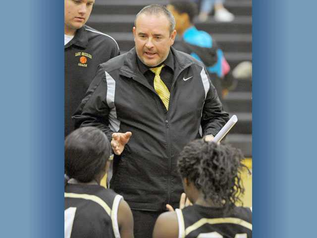 New Golden Valley varsity girls  basketball head coach Daniel Veluzat talks to his team during a game Dec. 8 at Golden Valley High School. This Winter, eight new coaches have taken over at Foothill League schools.