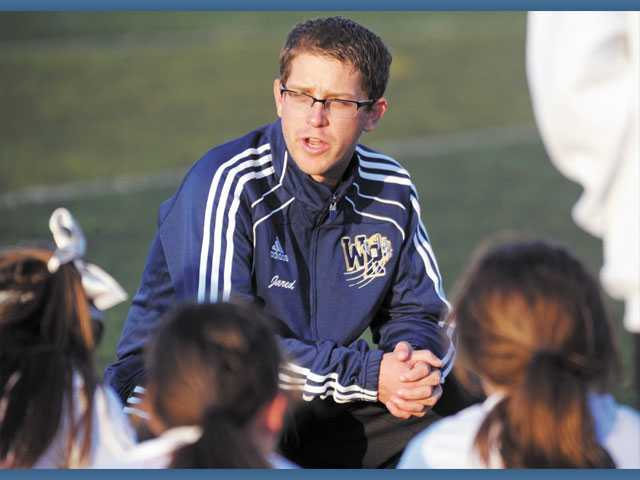 First-year West Ranch girls varsity soccer Head Coach Jared White speaks to his team at halftime during a game against Ventura at West Ranch High School. White is one of eight coaches taking over in the Foothill League this season.