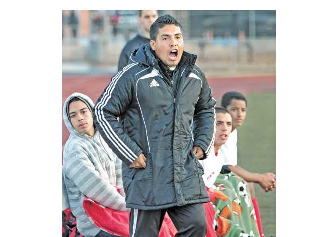 First Year Hart High School varsity boys soccer head coach Jovel Adonay instructs his team from the sidelines Thursday at Hart High.