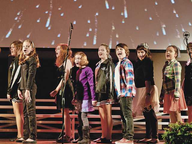 "Santa Clarita Valley International's seventh-graders sing ""My Corner of the Sky"" during the school's Winter Spectacular at Higher Vision Church on Dec. 8."