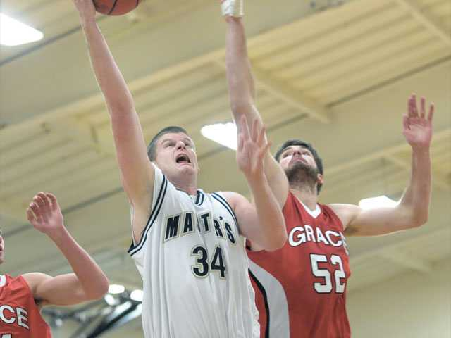 The Master's College's Anthony Wells (34) shoots as Grace College's Duke Johnson tries to block on Tuesday at TMC.