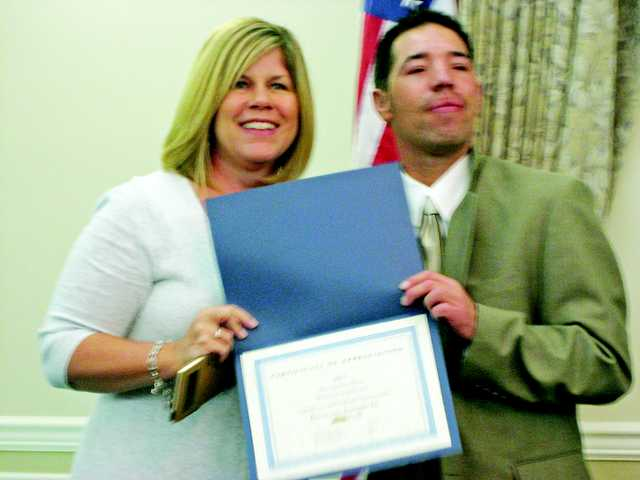 Santa Clarita Mayor Laurie Ender presents a certificate to Pleasantview Industries program particpant Mario Hidalgo.