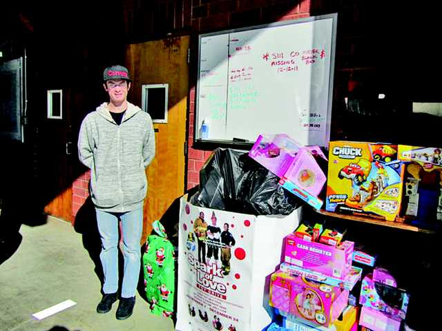 Andy Zager stands by some of the collected toys.