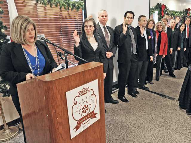 City of Santa Clarita Mayor Laurie Ender, left, reads the oath of office as the new VIA board members raise their hands during the swearing-in ceremony held at the Valencia Country Club in Valencia on Tuesday.