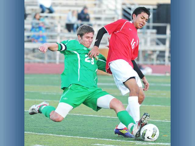 Hart's Brayon Rodriguez, right, tries to win the ball from Lancers defender Luke Hoffman on Thursday at Hart High.