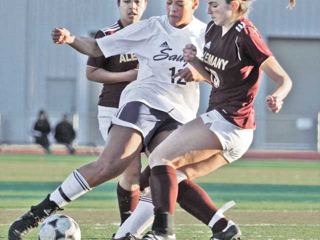 Saugus defender Angie Weiner (12) fights for the ball against Alemany's Savanna Forry, right, and Amber Edemann during Thursday's game at Saugus High School. Saugus finished the game with four shots on goal.